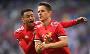 Jesse Lingard congratulates Ander Herrera after the Spaniard's winner against Tottenham, which booked Manchester United's place in the FA Cup final.
