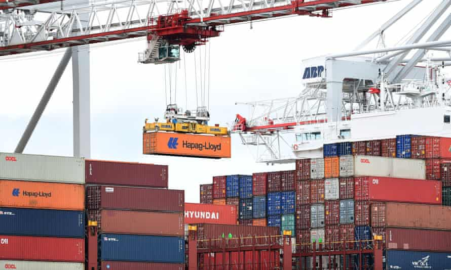 a crane removes containers from a ship