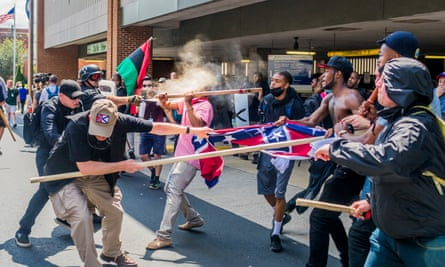 White supremacist groups clash with counter-protesters during Unite the Right rally in Charlottesville, Virginia on 12 August 2017.