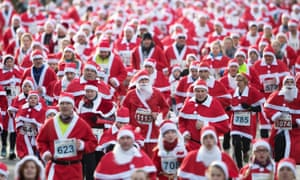 participants dressed in father christmas costumes take part in the traditional santa claus run in michendorf - Santa Claus Red