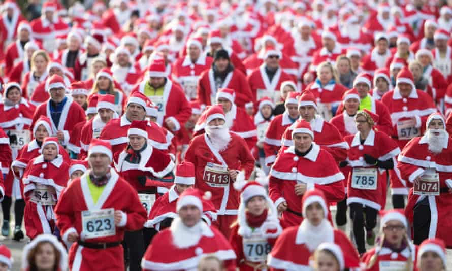 Participants dressed in Father Christmas costumes take part in the traditional Santa Claus run in Michendorf, eastern Germany.