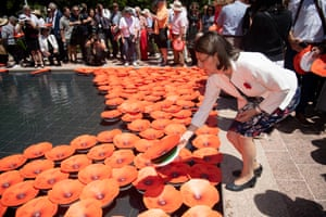 The New South Wales premier, Gladys Berejiklian, places a poppy into the newly completed Water Cascade on Remembrance Day