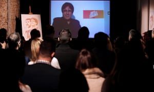 Catalonia's former president, Carles Puigdemont, addresses supporters in Barcelona via video-link from Belgium