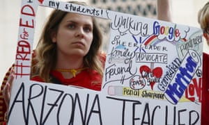 Striking teacher Taylor Dutro listens at the Arizona Capitol on 1 May in Phoenix. The teachers' union strongly back Saves Our Schools effort to overturn the voucher law.
