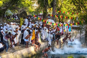 Boys jumping in the pool at Gondar, Ethipoia, during  Timkat (baptism) celebrations.