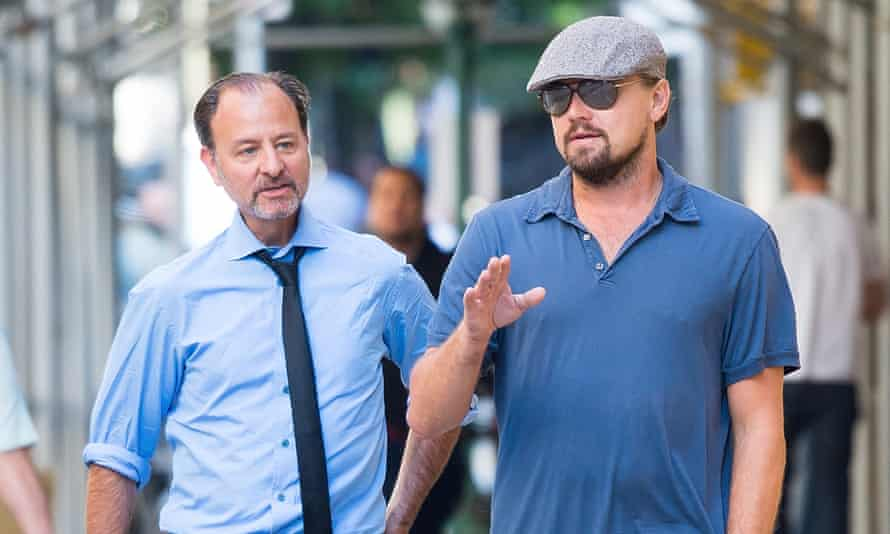 Leonardo DiCaprio and Fisher Stevens take a break outside a New York sound studio from working on the upcoming climate change documentary Before the Flood on 23 August 2016 in New York City.
