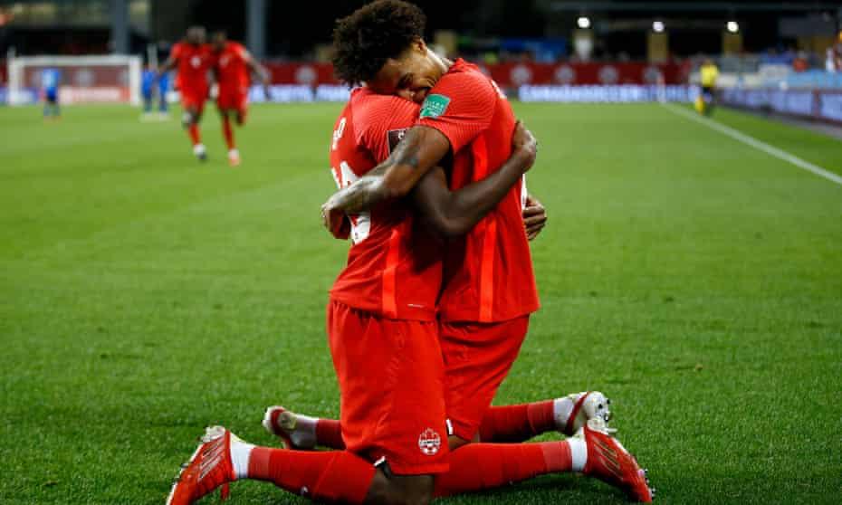 Tajon Buchanan and  Jonathan David celebrate a goal against El Salvador