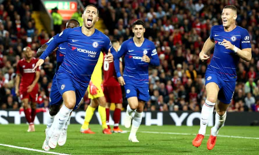 Eden Hazard (left) celebrates his stunning winner against Liverpool in the Carabao Cup tie at Anfield.