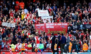 Arsenal supporters hold up banners targeting Stan Kroenke and Arsène Wenger at the home game against Everton, the final match of the league season.