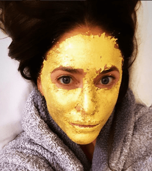 Lisa Snowden with gold face
