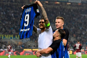 Mauro Icardi shows his shirt to supporters at the end of Inter's thrilling derby win.