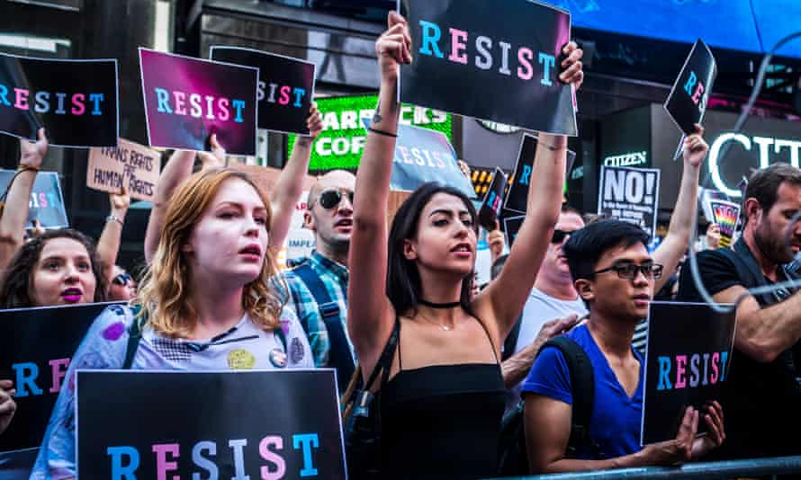 New Yorkers protest Donald Trump's transgender military ban. 'Any American who meets current medical and readiness standards should be allowed to continue serving,' said John McCain.
