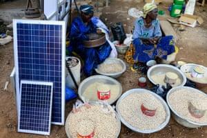 Solar panels are sold alongside food in a market in Burkina Faso.