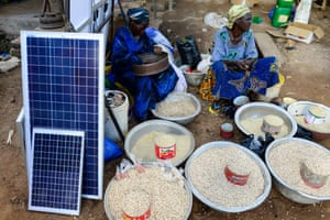 Solar panels are sold alongside food in a market in Burkina Faso.