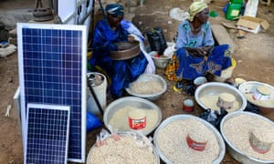 Grain and solar panels for sale at a market in Gaoua, Burkina Faso.