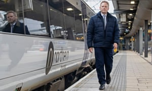 Grant Shapps by a train