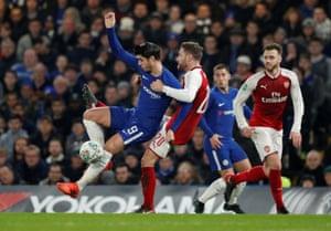Chelsea's Alvaro Morata shields the ball from Arsenal's Shkodran Mustafi.