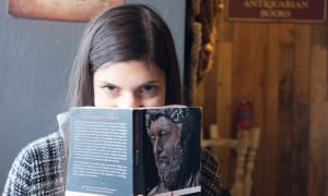 A reader with a copy of The Meditations of Marcus Aurelius