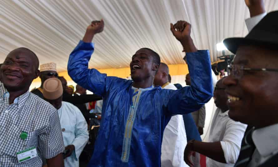 Supporters of Ibrahim Boubacar Keïta celebrate his re-election at campaign headquarters in Bamako on Thursday