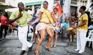 Revelers dance at National Day of Samba celebrations at Pedra do Sal