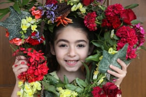 Kornos, CyprusA little girl poses holding a decorated magical wreath of flowers collected from the garden of her home to celebrate May Day