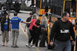 Students escorted school bus in front of STEM School Highlands Ranch after a shooting.