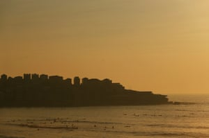 Smoke covers Bondi beach at dawn on Tuesday