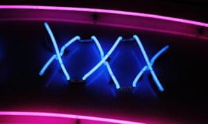 A neon sign advertising a sex shop