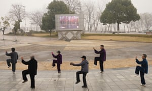Wuhan residents practice tai chi at a park in central China's Hubei province on Saturday, 23 January 2021