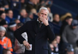 Alan Pardew watches on with dismay and the home fans let him know their feelings by the end.