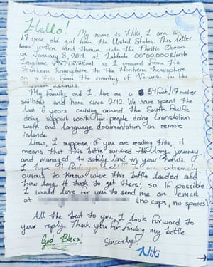 Message in a bottle. A note dropped by American teenager Niki Nie from a sailboat that washed up on a remote Papua New Guinean island