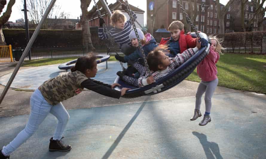 Children enjoying their local playground in Lambeth, south London.