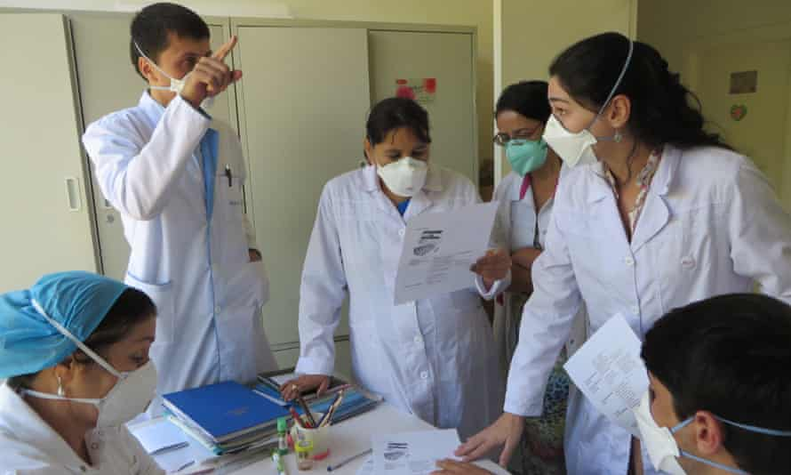 Dr Ana P Cavalheiro with an MSF team at Machiton Hospital in Tajikistan as a local Nurse explains how to use the new TB medication Dlm