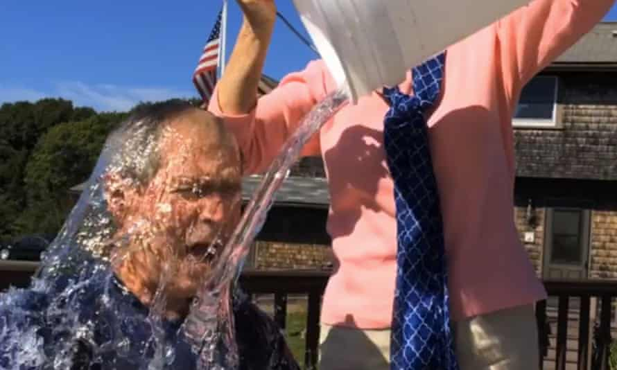In this image from video posted on Facebook, George W. Bush participates in the ice bucket challenge with the help of his wife, Laura Bush.