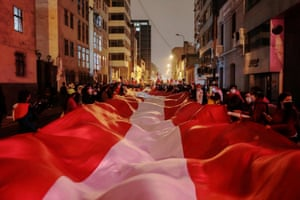 Lima, Peru Supporters of presidential candidate Pedro Castillo carry an oversized flag after a run-off election