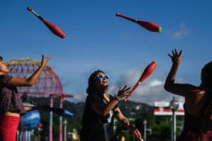 San Salvador, El Salvador. Jugglers on World Juggling Day at El Principito park