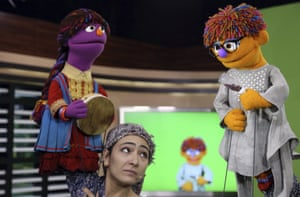 Afghan puppeteer Mansoora Shirzad with the two new Sesame Garden characters: Zari, left, and Zeerak.