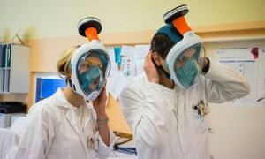 Medical workers from Motol hospital wear snorkel masks transformed into high-grade protection by researchers from The Czech Institute of Informatics, Robotics and Cybernetics at Czech Technical University in Prague, Czech Republic 25 March, 2020.