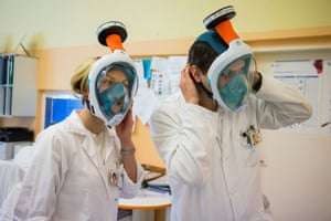 Prague, Czech RepublicMedical workers wear snorkel masks transformed into high-grade protection at Czech Technical University.