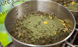 A batch of tea leaves and other ingredients being brewed to make Virginia First Tea Farm shampoo and conditioner.