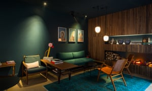 Interior of the Coq hotel, Paris, showing sofas and chairs in the lounge area.