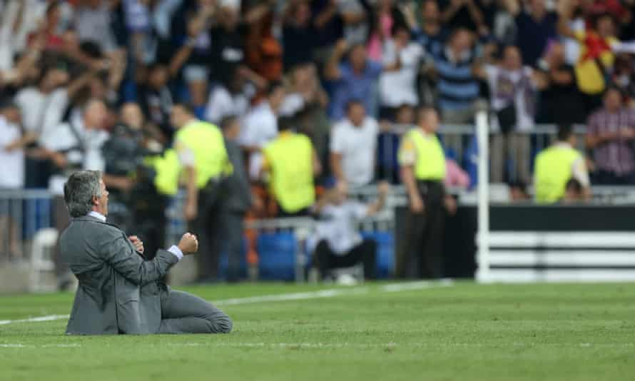 José Mourinho marks Cristiano Ronaldo's winning goal for Real Madrid against Manchester City at the Bernabéu in 2012 with a knee slide.