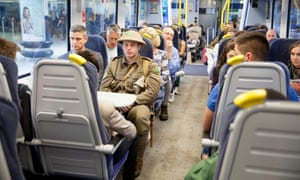 A 'soldier' takes part in We're Here Because We're Here by Jeremy Deller.