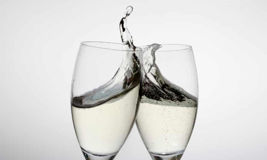 Toasting with two glasses of champagne<br>GettyImages-145065460