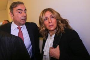 Carlos Ghosn and Carole Carole arrive to face the media.