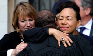 Harriet Harman (left) and Oona King embrace the Speaker's chaplain after a service to commemorate Jo Cox