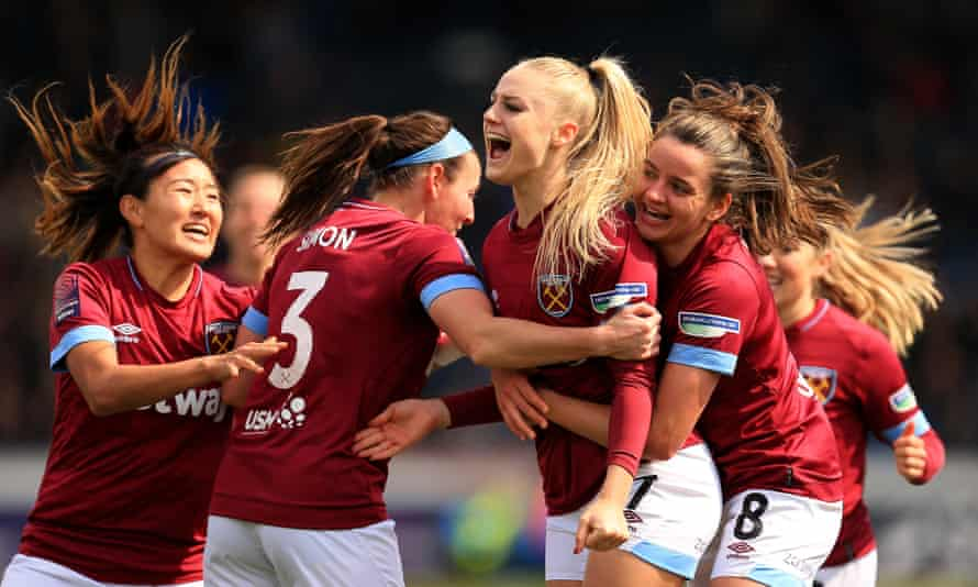Alisha Lehmann is mobbed by her West Ham teammates after scoring in the Women's FA Cup semi-final against Reading.