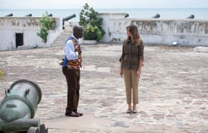 Kwesi Essel-Blankson, museum educator, shows her around Cape Coast Castle, a former slave trading fort.