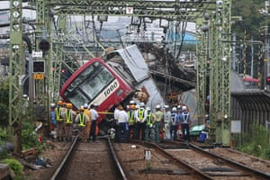 Yokohama, Japan: A passenger train collided with a fruit truck, causing sections of the train to derail
