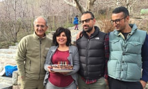 Iranian environmentalist Kavous Seyed-Emami (left), his wife Maryam Mombeini and their sons Ramin and Mehran.